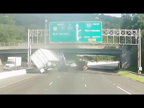 Video shows tractor-trailer overturn in alleged road rage crash