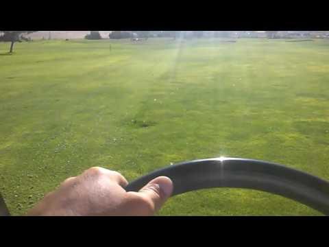 Cutting fairways on a golf course.
