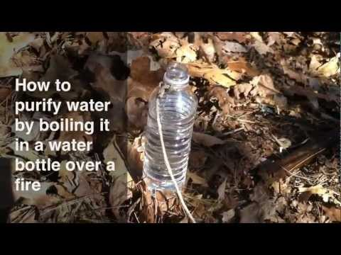 Boiling water purification in a water bottle over a fire