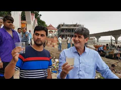Demonstration of jerrycan at ganga river, india - portable water filter - survival jerrycan