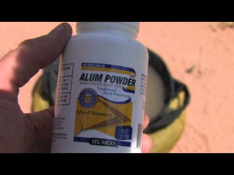 Using alum for extracting silt from river water for drinking and cooking while camping.